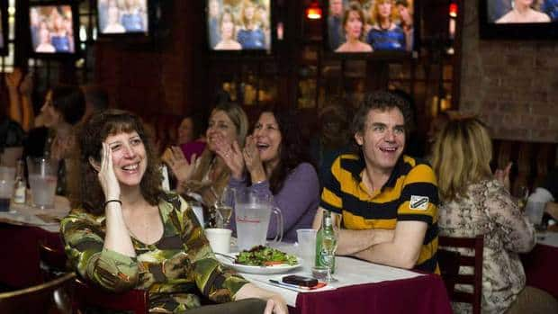 Fans gather at a New York sports bar to watch the final episode of the soap opera All My Children on Sept. 23, 2011. The soap resumes April 29 online.