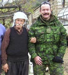 Maj. Paeta Hess-von Kruedener poses for a photo with a villager in Bourhoz in southern Lebanon in March. (CTV News/CP)