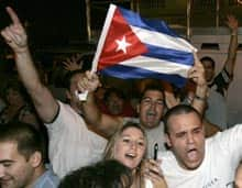 Cuban-Americans chant anti-Castro slogans Monday night in the Little Havana section of Miami, after hearing about Fidel Castro's health.