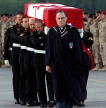 Military pallbearers carry the casket of Maj. Paeta Hess-von Kruedener, whose remains returned to Canada on Aug. 4, 2006.