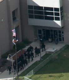 Members of a SWAT team exit Platte Canyon High School in Bailey, Colo., during Wednesday's hostage-taking.