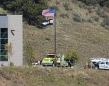 Paramedics transport a shooting victim out of Platte Canyon High School during the hostage standoff that resulted in the death of one student, and the gunman killing himself.
