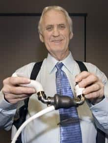 Mechanical heart recipient Gérard Langevin shows a model of his implant at a news conference in Montreal on Wednesday.