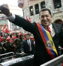 Venezuelan President Hugo Chavez greets supporters as he rides in an open car toward the Congress in Caracas Wednesday.