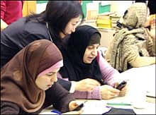 Students at the Mennonite Centre for Newcomers are testing mobile learning - downloading an English grammar lesson, then answering a series of multiple choice, or true or false questions.
