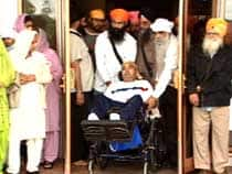 Supporters wheel Laiber Singh out of the Kalgidhar Darbar Sahib Society temple where he had taken sanctuary in Abbotsford , to speak to reporters, July 9, 2007.
