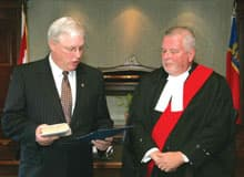 William Elliott (left) was sworn in Monday by Justice Stephen Brown in Ottawa.