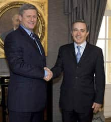 Prime Minister Stephen Harper, left, shakes hands with Colombian President Alvaro Uribe at the Presidential Palace in Bogota, Colombia. Harper is on a week-long state visit to Colombia, Chile, Barbados and Haiti to promote trade relations.