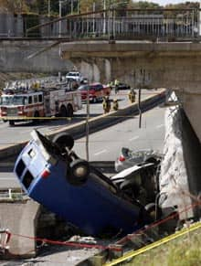 Rescue workers survey the site of an overpass that collapsed onto Highway 19 in Laval, Que., on Sept. 30, 2006.