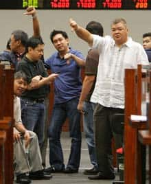 Floor traders signal the trend in the market Friday at the Philippine Stock Exchange.