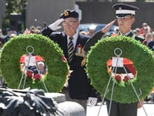 Dieppe veteran Frank Herring (left) salutes after laying a wreath during a ceremony of remembrance for the 65th anniversary of the Dieppe Raid at the National War Monument in Ottawa on Sunday.