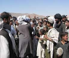 Afghans protest the presence of foreign troops in the Senzari area of Zhari district on Wednesday.