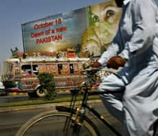 A billboard welcoming former Pakistani prime minister Benazir Bhutto stands on a roadside near the international airport in Karachi on Wednesday.
