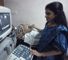Dr. Nayna Patel, right, examines a surrogate mother at Kaival Hospital in Anand, India. Anand's surrogate mothers, pioneers in the growing field of outsourced pregnancies, have given birth to roughly 40 babies.