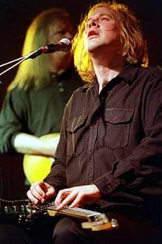Canadian musician Jeff Healey plays his unique sit-down style before a crowd in Windsor, Ont., in July 2001.