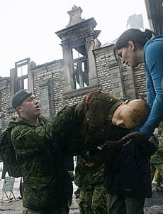 Soldiers help salvage materials from the armoury in Quebec City on Saturday.
