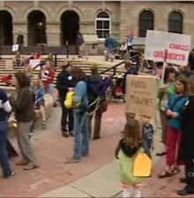 Midwives and supporters of midwifery rallied Monday in Calgary to call on Alberta to fund the service.