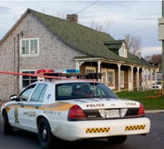 A police car sits in front of the house where Nancy Michaud's body was discovered.