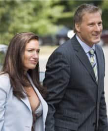 Julie Couillard arrives with her then boyfriend, Maxime Bernier, for his cabinet swearing-in ceremony in August 2007. Bernier later resigned as foreign affairs minister after leaving classified documents at Couillard's house.