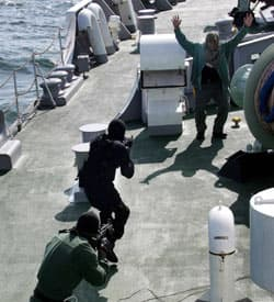 Malaysian police amphibious assault unit personnel conduct a joint anti-piracy exercise with Japanese and Thai forces off Andaman sea in 2007 to increase coordination among marine police of neighboring countries in stamping out piracy.