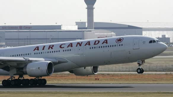 Air canada ordered to accommodate people with nut for Air canada pet in cabin