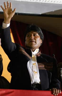 Bolivian President Evo Morales, right, waves to supporters from the balcony of the presidential palace in La Paz on Sunday. Voters strongly reaffirmed their faith in Morales on Sunday in a recall referendum.