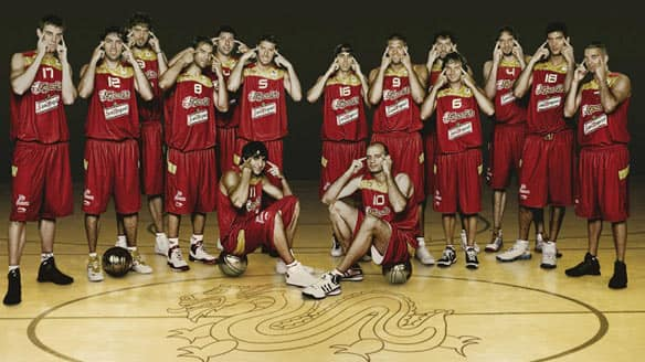 Members of Spain's Olympic men's basketball team make gestures as they pose for an Olympics publicity photo. Toronto Raptors point guard Jose Calderon (No. 8) is a member of the team.