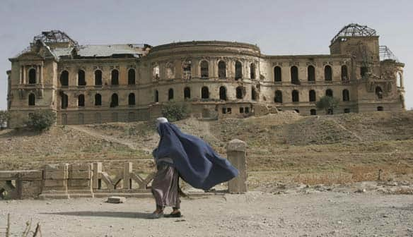 kabul afghanistan pictures. An Afghan woman walks past the