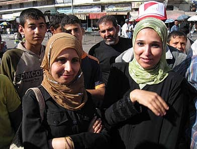 A Gaza woman, left, tells the CBC: 'We live in a prison. If we want to criticize, it's forbidden. ...  It's our neighbours who are oppressing us.'