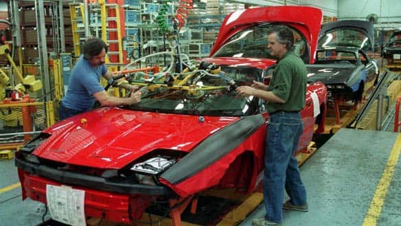 Workers put the windshield into a Camaro at the General Motors plant in Ste. Therese, Que. The plant shut down in 2002.