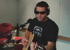 Jose Neto, shown here singing a Portuguese song in a CBC studio, has been chosen to test a new device that could help him \