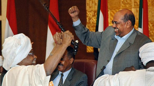 Sudanese President Omar al-Bashir, right, is greeted by a supporter during a conference in Khartoum on Wednesday.