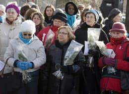 Women gather Saturday at a memorial for the Polytechnique massacre in Montreal.
