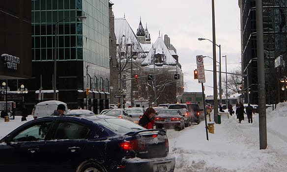 With no buses on the road, Ottawa commuters headed to work on foot and by car on Wednesday.