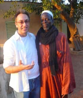 CBC reporter David Gutnick with Lamine Coulibaly, chief of Banankabougou village, Mali. (CBC)