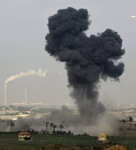 With the Israeli city of Ashkelon in the background, an Israeli missile explodes in the Gaza Strip on Monday.