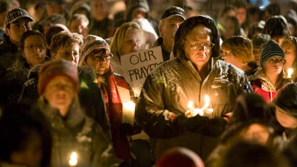 Mourners gather at a candlelight vigil in Sparwood, B.C., on Monday night to remember those lost during Sunday's avalanches.