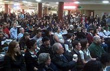 A crowd gathers on the University of Calgary campus on Tuesday to watch U.S. President Barack Obama's inauguration on a large TV in the food court of the students' centre.
