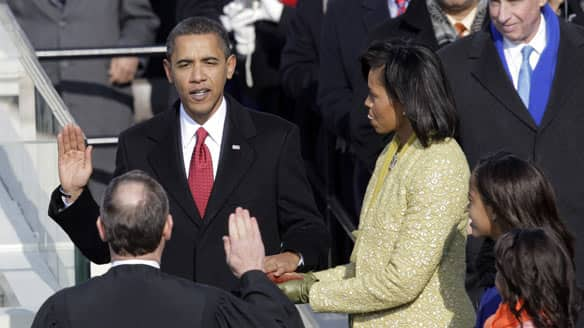 Barack taking the oath of office; Michelle getting really turned on