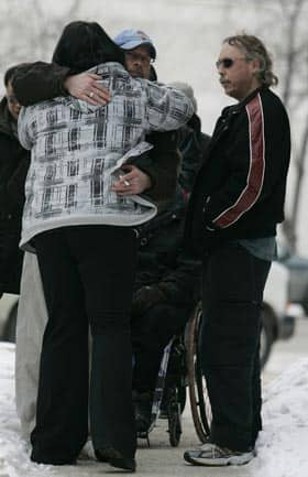 Family and friends of Tim McLean comfort each other outside the Law Courts in Winnipeg on Tuesday.