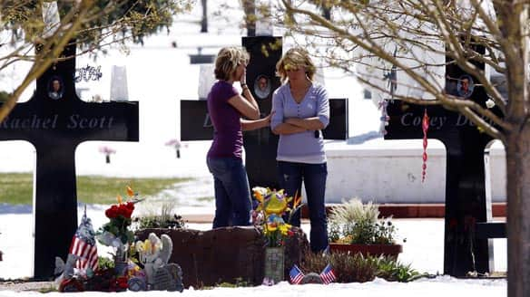 Cassie Sadusky, 25, left, and her sister Jetta, 22, visit the gravesites of Columbine students Corey DePooter and Rachel Scott at Chapel Hill Memorial Gardens near Littleton, Colo., on Monday.