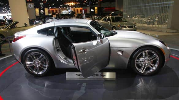 A Pontiac Solstice Coupe is displayed at the LA Auto Show in Los Angeles in