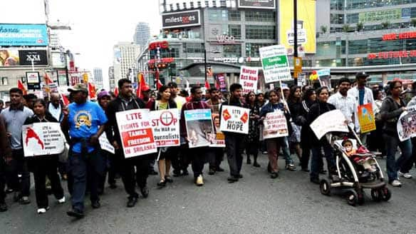 Thousands of Tamil demonstrators took over Toronto's Yonge Street late Wednesday after a day-long protest at the provincial legislature at Queen's Park. Here a line of demonstrators pass Dundas Square.