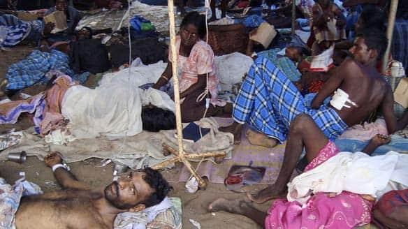 tamils wait at a makeshift hospital in mullivaikal sri lanka on