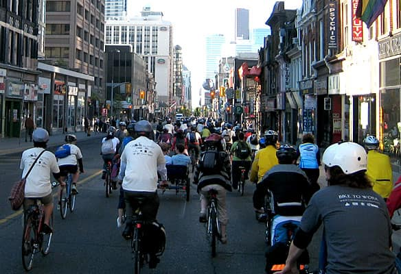 Torontonians roll down Yonge Street toward City Hall on Bike to Work Day in 2009.
