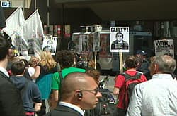 Protesters gathered across the street from the Toronto convention centre where George W. Bush and Bill Clinton were speaking Friday.