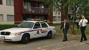 IHIT investigators secured the area around the apartment after RCMP officers found a woman's body inside on Monday.