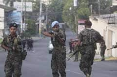 Soldiers patrol in front of the residence of President Manuel Zelaya in Tegucigalpa on Sunday.