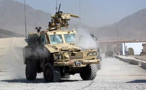 A Nyala armoured vehicle hit by a suicide bomber in September 2006 limps back to the Provincial Reconstruction Team base in Kanadahar, Afghanistan.