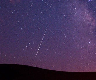A meteor streaks across the sky Tuesday over Vinton, Calif., during the annual Perseid meteor shower.